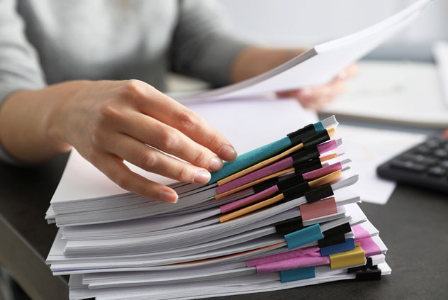 Office employee working with documents at table